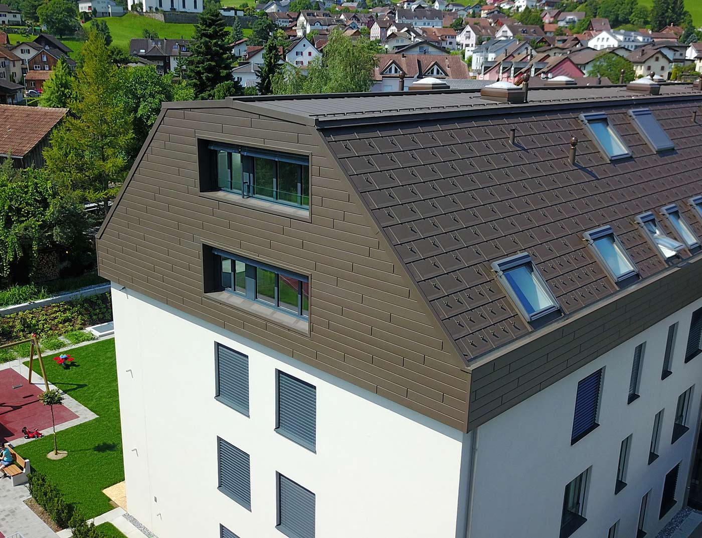 Reference buildings PREFA Roof systems R.16 roof tile 01 P.10 brown